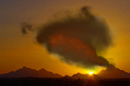 Illustration of a volcano at sunset. Stock Photo
