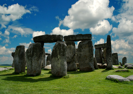 megalith: Summer Stonehenge in the background of a cloudy sky.