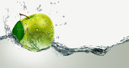 fruit in water: Green Apple amid splashing water.