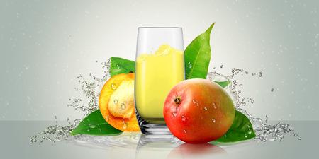 fruit juice: A glass of mango juice with mango fruit.