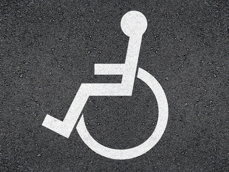 disabled person: Marking the disabled person on asphalt. Stock Photo