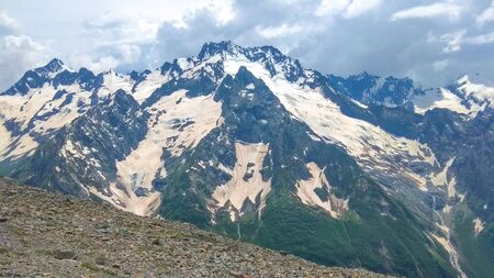 Mountain, summer landscape on the background of snowy peaks 写真素材
