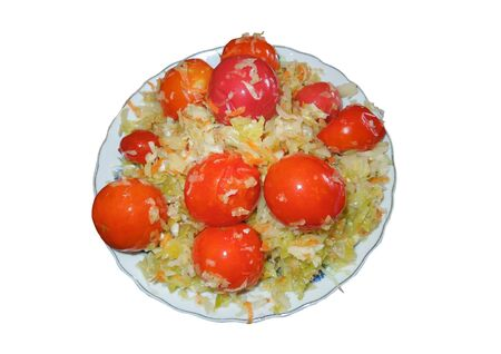 Sauerkraut with tomatoes on a plate, on a white background