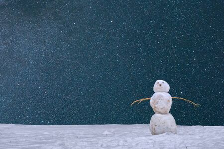 New Year, Christmas card with a snowman and falling snow.