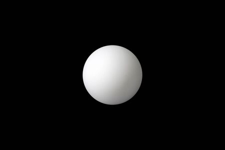 Tennis ball on a black, isolated background.