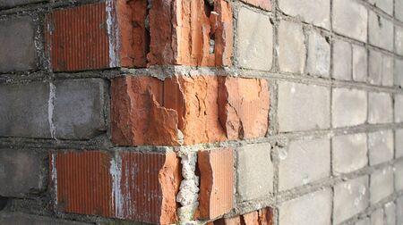 Texture of broken brickwork of an abandoned house
