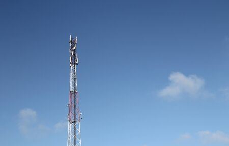 Relay tower on a background of blue sky. 写真素材