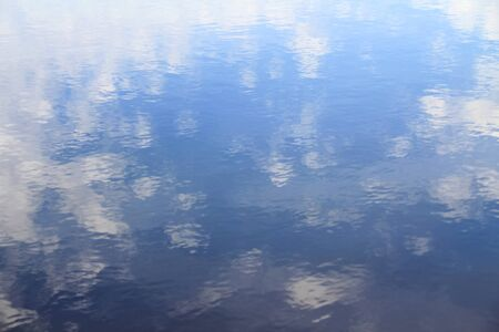 Clouds reflection in pure lake water. Heaven and clouds in water 写真素材