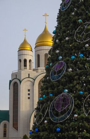 Christian temple in Kaliningrad, against the background of the New Year tree. Photographed in December 2019.