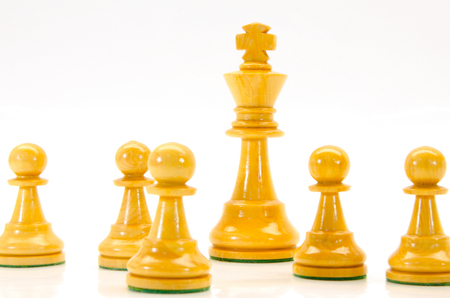illustration of wooden chess figures with king in the middle illustration