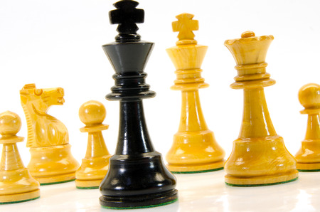 situational: illustration of wooden chess figures with king in the foreground Stock Photo