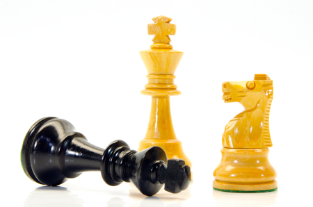 situational: illustration of wooden chess figures with king lying Stock Photo