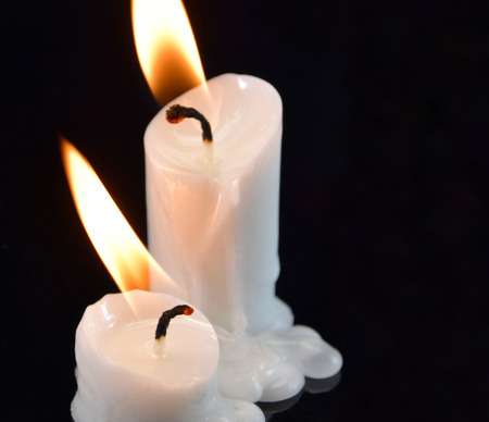 picture of burning candles on black background photo