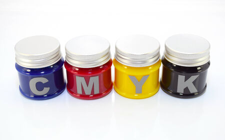 small bottles with the four basic printing colors photo