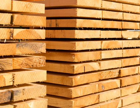 sawed: closeup of stack with recently sawed wooden boards