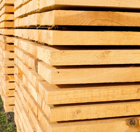 recently: closeup of stack with recently sawed wooden boards