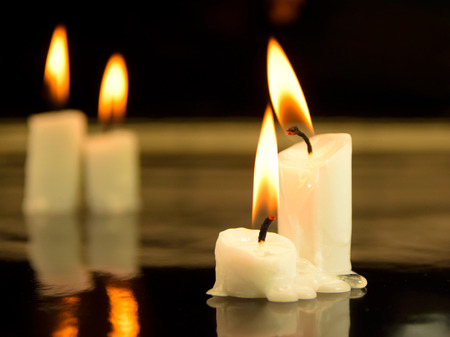 picture of some candles in a dark surrounding photo