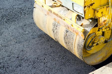 steamroller: close-up of steamroller smoothing asphalt on a street Stock Photo