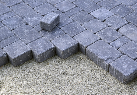 recently: closeup of recently laid cobbles for a driveway Stock Photo