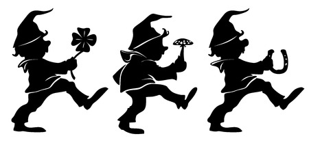 good luck charm: little dwarfs dancing with good luck charm Stock Photo