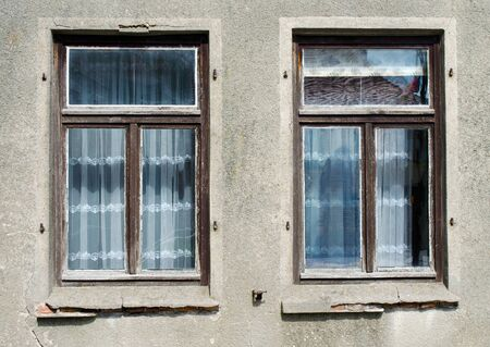 old windows: two old windows of an old house