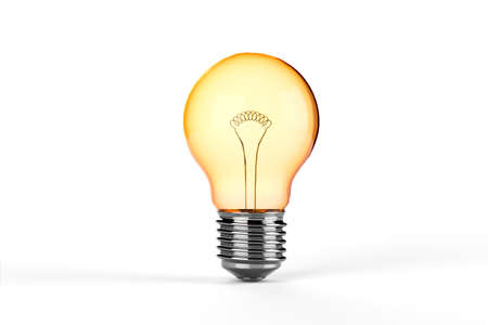 Yellow Incandescent Light Bulb - isolated photo