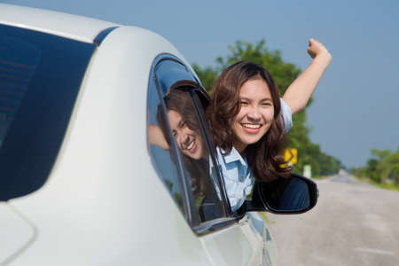 young female: Asian woman, Young female driving happy about her new car or drivers license