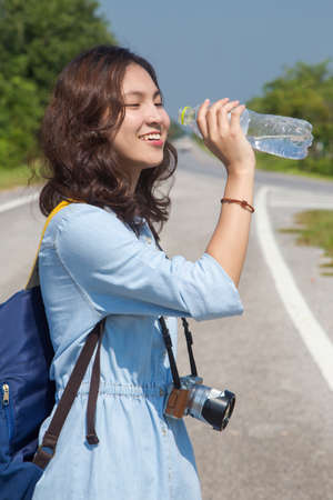 out door: woman very happy out door travel drinking water Stock Photo