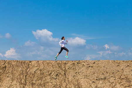 women sport: Wide angle of woman running, sport concept, Athlete training on morning. Stock Photo
