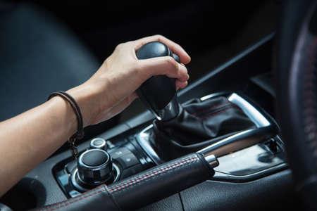 girl driving car moving transmission shift gear Фото со стока