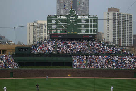 Chicago - April 22, 2008: Cubs fans watch an early spring contest with New York Mets from their famous bleachers.