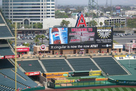 Anaheim, California - April 26, 2007: Early arriving Angels fans await a spring baseball game under the scoreboard at classic Los Angeles Angel Stadium Of Anaheim.