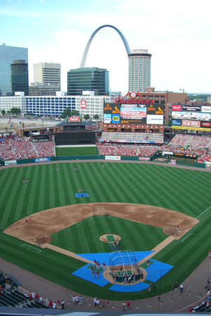 St. Louis, Missouri - May 30, 2006: Cardinal fans watch batting practice at Busch Stadium with a view of the Gateway Arch