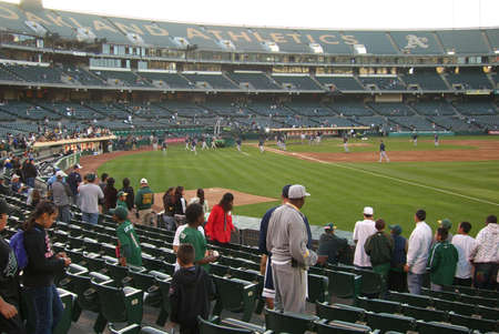 Oakland, California - September18, 2007: Athletics fans watch batting practice before a late season baseball game.