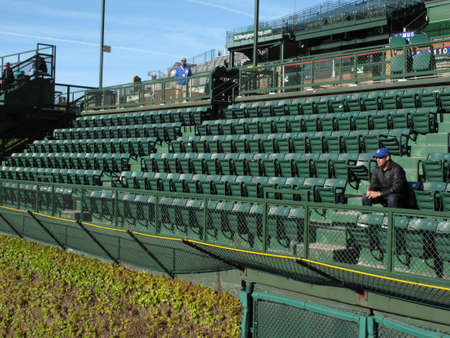 bleachers: Chicago, Illinois - April 26, 2010: First Cubs fan to arrive in famous Wrigley Field bleachers Editorial