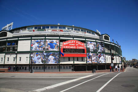 Chicago, Illinois - April 26, 2010: A new look on Addison Street for historic Wrigley Field and the famous welcome sign of the Chicago Cubs Editorial