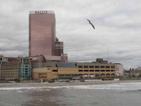 Atlantic City, New Jersey - May 19, 2010: Boardwalk, Bally Casino Hotel and the New Jersey shore