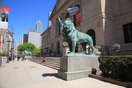 Chicago, Illinois - April 26, 2010: Chicago Art Institute near Grant Park in Chicago, Illionois. Famous lion statues are found outside on Michigan Avenue. Editorial