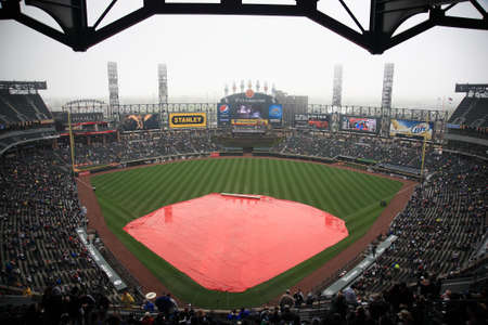 Chicago, Illinois - April 25, 2010: White Sox rain delay at U.S. Cellullar Field, including the upper deck facade. Stock Photo - 9020911