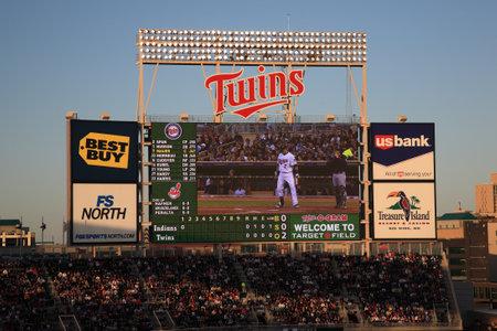 scoreboard: Minneapolis, April 21, 2010: Scoreboard Joe Mauer of the Minnesota Twins at a night game at Target Field.