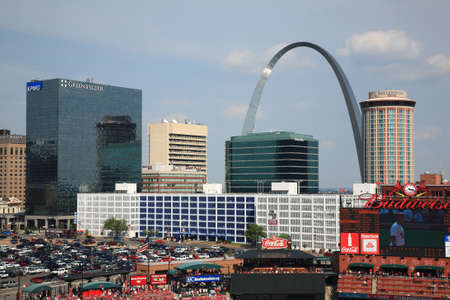 St. Louis, September 18, 2010: Fans gather for a late season Cardinals game at Busch Stadium, under the Gateway Arch. Editorial