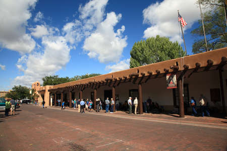 nm: Santa Fe, New Mexico - September 23, 2010: Shoppers and tourists at the Native American market at the Palace of the Governors in Santa Fe.