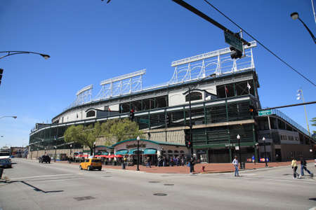 Chicago, Illinois - April 26, 2010: Corner of Addison Street and Sheffield Avenue, famous address for Wrigley Field, home ballpark of the Chicago Cubs. Stock Photo - 9063168