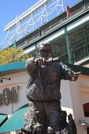 harry: Chicago, Illinois - April 26, 2010: Harry Caray statue at corner of Addison Street and Sheffield Avenue, famous address for Wrigley Field, home ballpark of the Chicago Cubs.