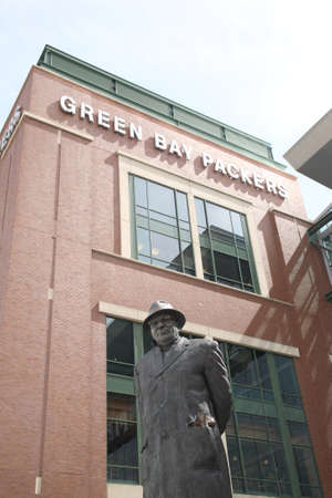 tundra: Green Bay, Wisconsin - April 23, 2010: Vince Lombardi statue at historic Lambeau Field in Wisconsin. The Packers NFL stadium is sometimes referred to as the Frozen Tundra. Editorial