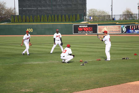 outfield: Midland, Michigan - April 15, 2010: Baseball players pre-game workout for the minor league baseball team Great Lakes Loons in Midland Michigan.
