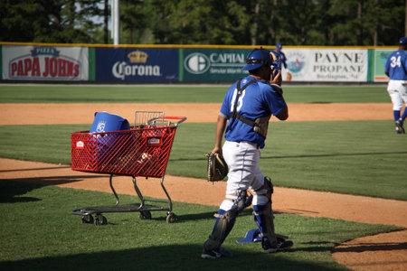 royals: Burlington, North Carolina - June 29, 2009: Minor league baseball catcher during infield practice for the Burlington Royals.