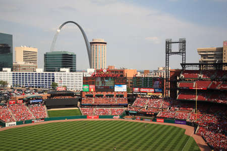 louis: St. Louis, September 18, 2010: Fans gather for a late season Cardinals game at Busch Stadium, under the Gateway Arch. Editorial