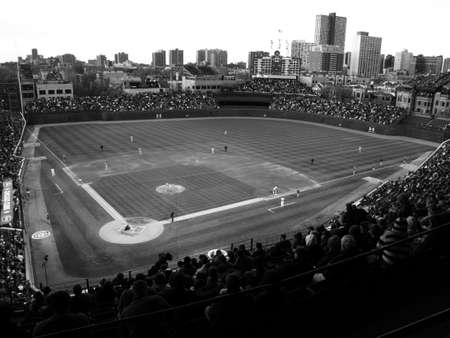 pitting: Chicago, Illinois - April 26, 2010: Wrigley Field night game pitting the Chicago Cubs against the Washington Nationals. Black and white.