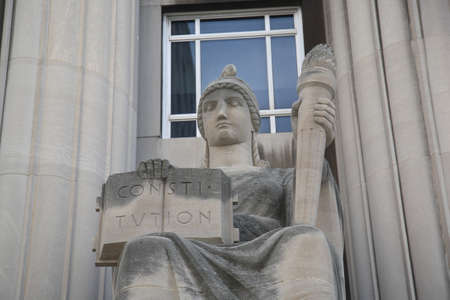 St. Louis, September 18, 2010: Mel Carnahan Courthouse. Constitution and torch statue at the former Federal Courthouse in St. Louis, Missouri. The building was constructed in 1935 with allegorical figures. Editorial